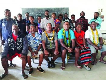 Fr Epokifo'ou, front centre; Fr Eneriko, right of Epokifo'ou; and Fr Louis, far right; with Teachers and Parishioners in Tanna