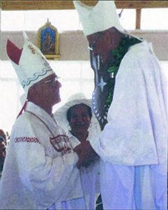 Bishop Stuart O'Connell SM (left) is greeted by Bishop Robin Leamy SM, the ordaining bishop, at Bishop O'Connell's episcopal ordination
